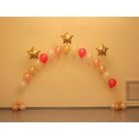 Гелиевая арка из золотых и розовых шаров с золотыми звёздами