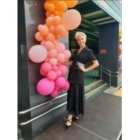 Оранжево-розовая разнокалиберная гирлянда из шаров