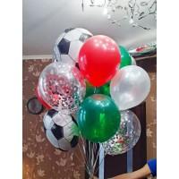 Гелиевый фонтан с фольгированными кругами в виде футбольных мячей