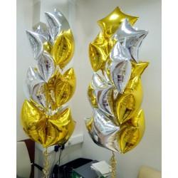 Фонтаны из золотых и серебряных фольгированных звезд