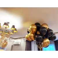 Связка из 20 золотых и черных шаров